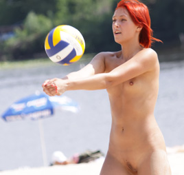 Young nudist shows off her slim body