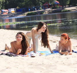 Thin young teen nudist play at the  beach